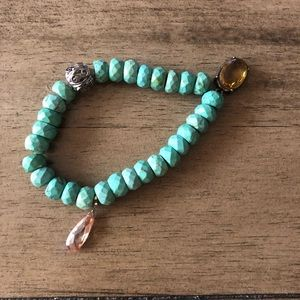 Turquoise beaded bracelet with charms